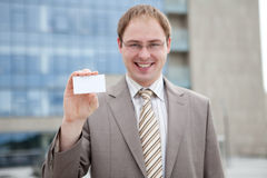 Business man handing a blank business card. (outdoor the office Stock Image