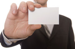Business man handing a blank business card Stock Photo