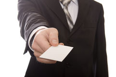Business man handing a blank business card Royalty Free Stock Image
