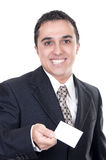 Business man handing a blank business card Royalty Free Stock Images
