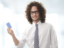 Business man handing a blank business card Stock Photos