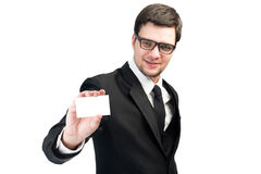 Business man handing a blank business card. On isolated backgrounds royalty free stock photography