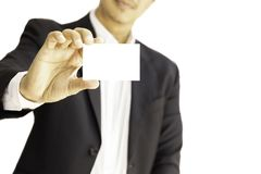 Business man handing blank business card isolated in clipping path. royalty free stock photos