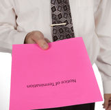 Business man handing out a notice of termination or pink slip Stock Photography
