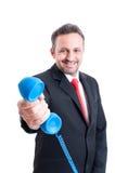 Business man handing telephone Stock Image