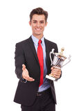 Business man handing a trophy  and handshaking Royalty Free Stock Photos