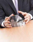 Business man hands around house model Royalty Free Stock Photography