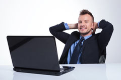 Business man with hands behind head Royalty Free Stock Image