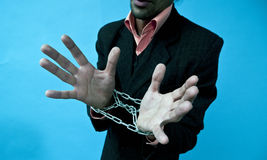 Business man with hands in chains Stock Photography