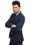 Business man with hands crossed looking away from the camera Royalty Free Stock Image