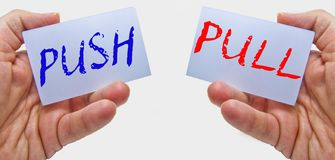 Business man hands handling cards with push pull words royalty free stock photo