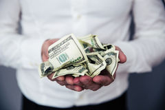 Business man hands holding money Royalty Free Stock Image