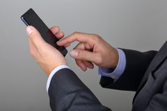 Business man hands holding smartphone Stock Photos