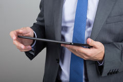 Business man hands holding tablet pc Stock Photos