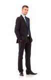 Business man with hands in pockets Royalty Free Stock Image