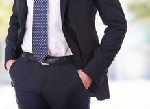 Businessman with hands in pockets. Royalty Free Stock Images