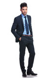 Business man with hands in pockets smiling Royalty Free Stock Photos