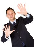 Business man with hands on the screen Stock Photography