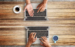 Business man hands using a laptop Stock Images
