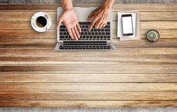 Business man hands using a laptop Stock Photo