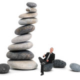 Business man in handshake position on a pebble Stock Images