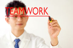 Business man handwriting TEAMWORK on  on visual screen Stock Images