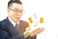 Business men happy to see the golden dollar icon. Business man happy to see the golden dollar icon, business success concept Stock Photos