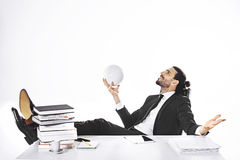 Business man has football glory dreams in office Royalty Free Stock Images