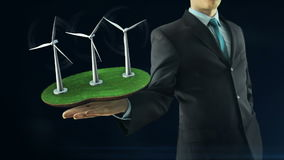 Business man has on hand green energy concept build animation windmill black stock footage