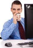 Business man have a drink on his office Stock Photography