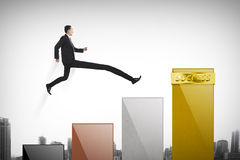 Business man have long leg so he can jump to the top graph Stock Image