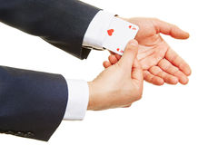 Business man having an ace up his sleeve Stock Image