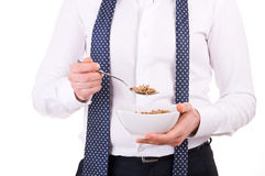 Businessman having breakfast with cereal bowl. Stock Photos