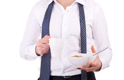 Businessman having breakfast with cereal bowl. Stock Photo