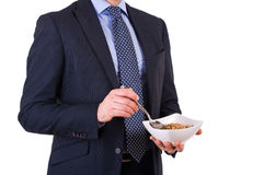 Businessman having breakfast with cereal bowl. Stock Image