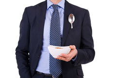 Businessman having breakfast with cereal bowl. Royalty Free Stock Photography