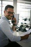 . .Business man having conversation on Landline phone. Bu. Caucasian business man having conversation on Landline phone. Business man in office. Looking at stock photography