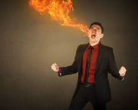 Business man having fire breath Royalty Free Stock Image