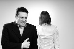 Business man having fun in office. Upset colleague in background Royalty Free Stock Photos
