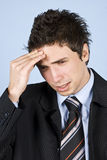 Business man having headache Stock Photos