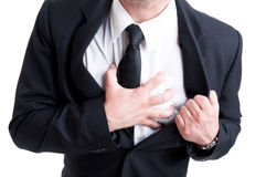 Business man having heart attack. And grabbing his chest in pain Royalty Free Stock Photo
