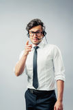 Business man with head-set. Businessman gestures with finger having a conversation with head-set Stock Image