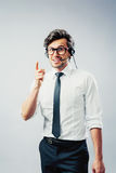 Business man with head-set. Businessman gestures with finger having a conversation with head-set Stock Photography