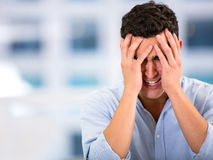 Business man with a headache Stock Image