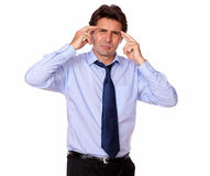 Business man with headache holding his forehead Stock Images