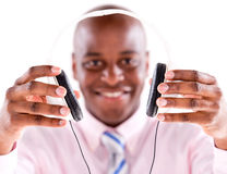 Business man with headphones Stock Images