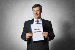 Business man with health insurance Royalty Free Stock Images