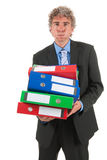 Business man with heavy archive Royalty Free Stock Photography