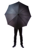 Business man hidden in umbrella Royalty Free Stock Photo