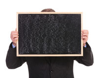 Business man hides behind blackboard Royalty Free Stock Images